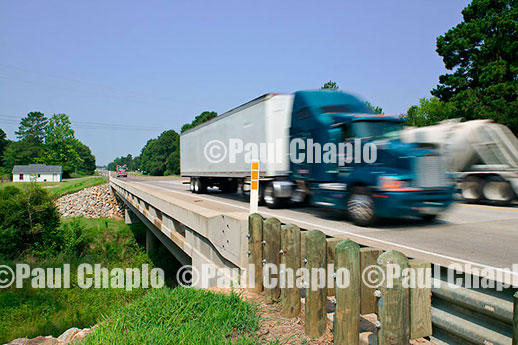annual report photography AR photographer style Dallas Texas TX Style Motion Action Shipping Transportation Road toll expressway Truck Bridges trucking Tollroads railroad trestle Cement Steel